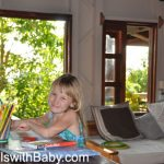 Child doing homework on vacation in Costa Rica