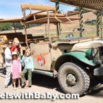 family with safari jeep