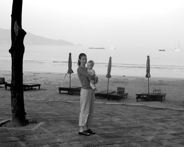 Early morning with travel baby #1 on Patong Beach, Thailand.