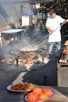 Cooking paella outdoors in Nerja, Spain