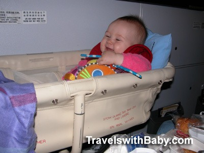 Baby in airline bassinet TravelswithBaby.com