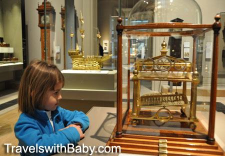 Child looks at clock in British Museum