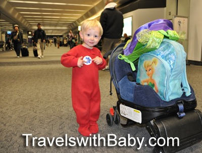 toddler  at the airport in red pajamas from travelswithbaby.com