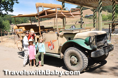 family with safari jeep