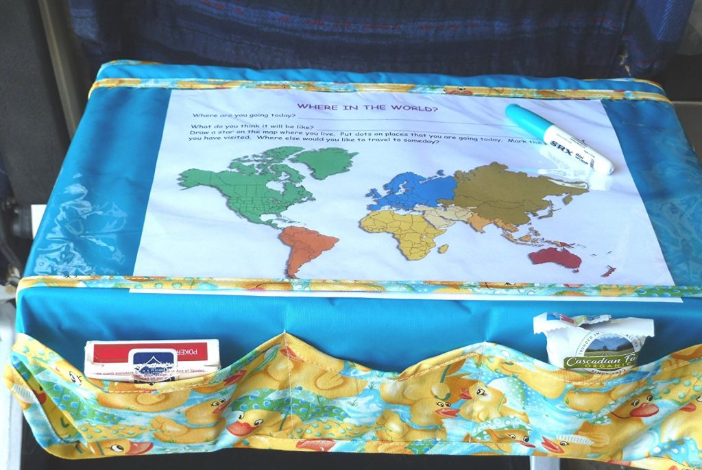 "The ""trayblecloth"" in action on an airplane seat-back tray."