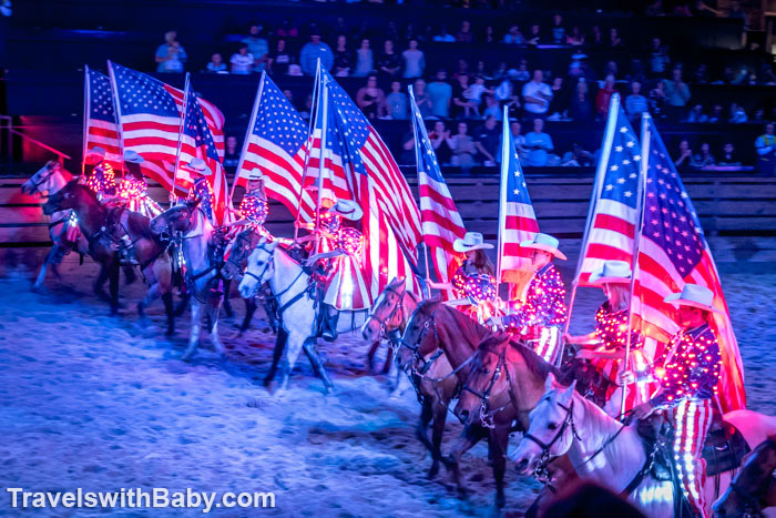 riders with glowing American flags and costumes
