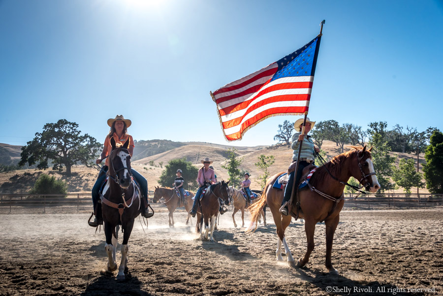 drill team riders on horseback with American Flag at the Alisal Ranch