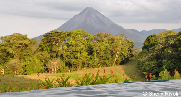 view from family swimming pool of Volcan Arenal in Costa Rica
