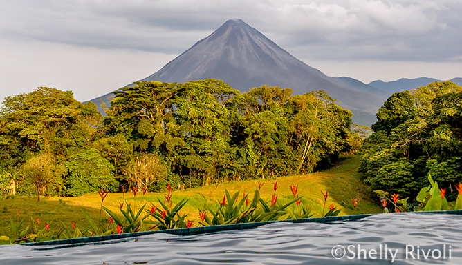 view of Arenal volcano from pool at Arenal Lodge, Costa Rica