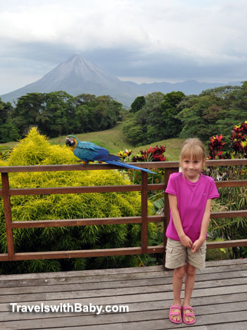 child posing with wild macaw at Arenal Lodge in Costa Rica