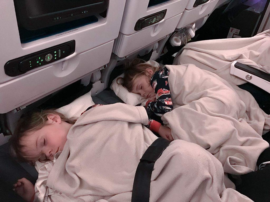 flying kids sleeping on seat extension leg rest