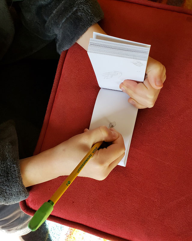kid making flipbook at home