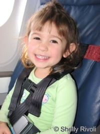 CARES flight harness on airplane www.travelswithbaby.com
