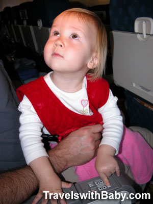 lap-held toddler on airplane travelswithbaby
