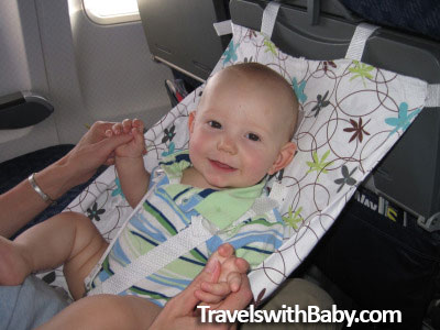 an early FlyeBaby baby hammock in use with infant on airplane