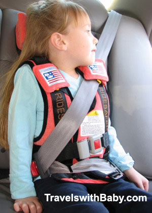 The RideSafer Travel Vest Deluxe installed with seat belt.